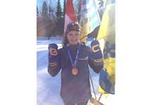 Local biathlete, Emily Dickson, skis fast to win bronze